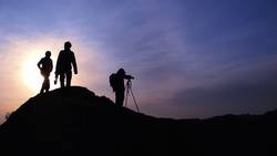 Silhouette of photographers on the mountains