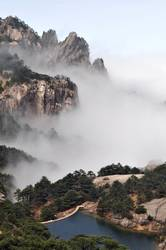 Landscape of mountains and lake in the morning fogs