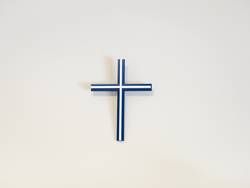 Blue and white catholic cross on a wall