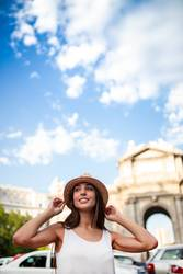 young tourist woman at puerta alcala madrid