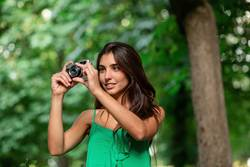 young beautiful tourist woman using a photo camera