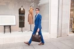 attractive businessman walking down the street