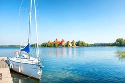 Trakai castle on lake with yacht
