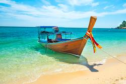 View of traditional thailand longtail boat at sand beach
