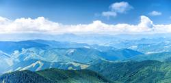 Panorama of blue mountains and hills