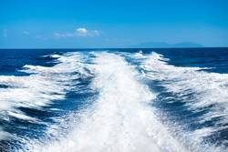 Wake of boat on water surface