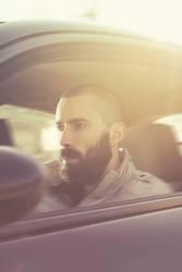 Man driving a car. Retro colors, motion blur