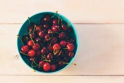 Fresh organic Cherries on a white wooden table