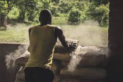 Working in Malawi with grain of maize