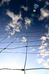 Zaun bis zu den Wolken