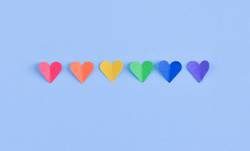 Row of hearts with GAY pride flag colors.