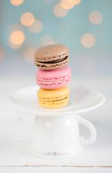 Three colorful macarons on a plate.