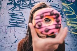 A beautiful woman's eye through a donut