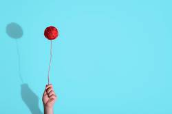 Knitting coil held in hand like balloon. Childhood concept