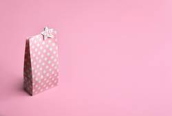 Pink gift bag with 24 number. Christmas advent calendar. Gifting