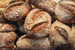 Rustic bread pile. Crusty bread background. Bakery products