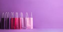 Multicolored paper shopping bags. Christmas shopping banner