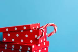 Red Christmas presents with candy canes. Xmas gifting concept