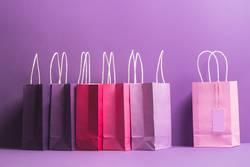 Colorful shopping bags with blank tag. Christmas gifting theme