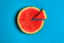 Sliced watermelon on blue background. Above view.