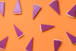 Pink pie slices pattern on orange background. Christmas dessert