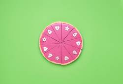 Pink chocolate pie sliced and Christmas Advent concept
