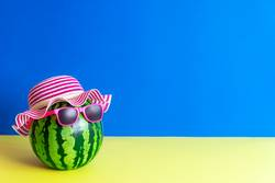 Funny watermelon with sunglasses. Summer concept.