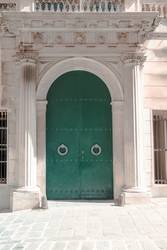 Arched ancient door on the streets of Genova