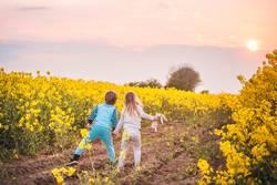 Kids walking towards the sunset