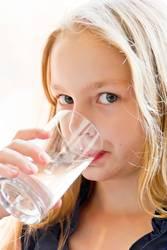 Caucasian girl drinking water