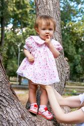 Cute infant in pink dress