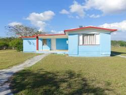 das blaue Haus in der Schweinebucht