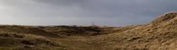 Dünenlandschaft mit Leuchtturm
