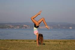 Yoga handstand at the beach