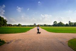 Young woman standing in a London park.