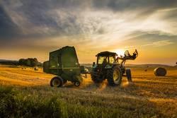 Farmer harvesting hay