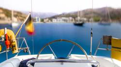 sailboat cockpit with blurry bay in the background