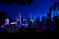 Line of blue and pink lightened tombstones during dawn