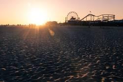 Silhouettes walking along Santa Monica beach during sunset