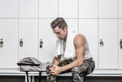 Sportsman resting in changing room