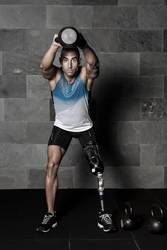 Muscular sportsman with prosthesis working out