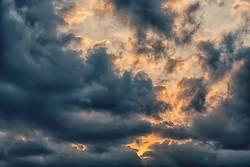 the empty sky and the sun near the cloud