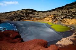 in el golfo lanzarote spain musk pond rock stone sky