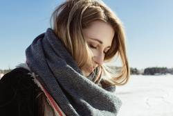 Closeup portrait of white female in a scarf on a frozen river