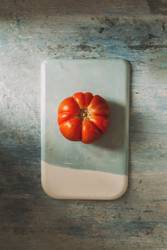 Fresh red Marmande RAF red tomatoes on stone table