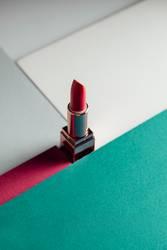 lipstick on modern colorful geometric background