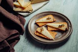 Semi-cured cheese rosemary sliced on toasted bread