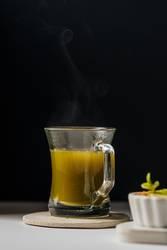 Hot matcha tea in transparent cups