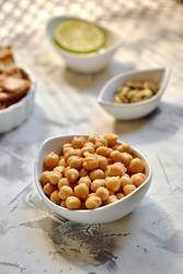 Chickpeas cooked in white bow on the table ready