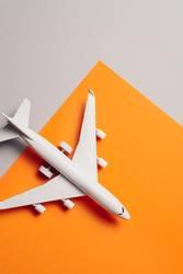 jet airplane travel concept, minimal art, orange background